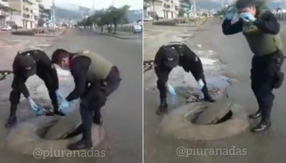 Policía intenta tapar el desagüe y se le cae la radio (Foto: Captura Piuranadas)