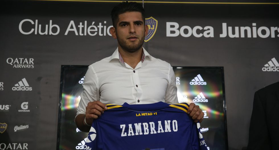 Carlos Zambrano, from Peru, poses for pictures as he is presented as a new Boca Juniors' player during a press conference in Buenos Aires, Argentina, Friday, Jan. 31, 2020. (AP Photo/Daniel Jayo)