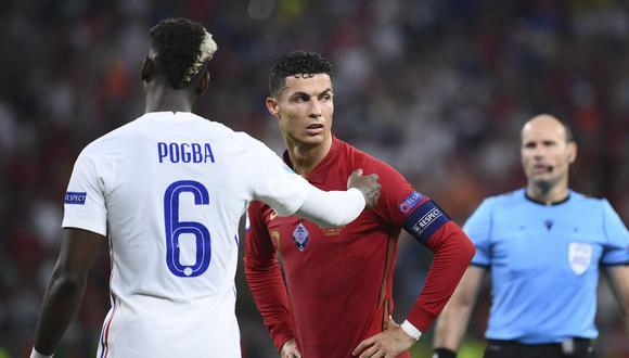 Paul Pogba y Cristiano Ronaldo podrían jugar juntos en PSG. (Foto: AP)