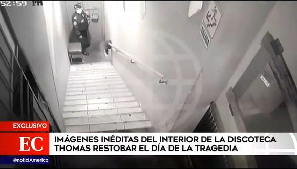 Un policía se encuentra en la puerta el día de la tragedia en discoteca de Los Olivos. (Foto: América Noticias)
