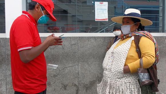 De acuerdo a las modalidades asignadas, las familias beneficiadas con el bono podrán acercarse a cobrar según la fecha establecida (Foto: AFP)